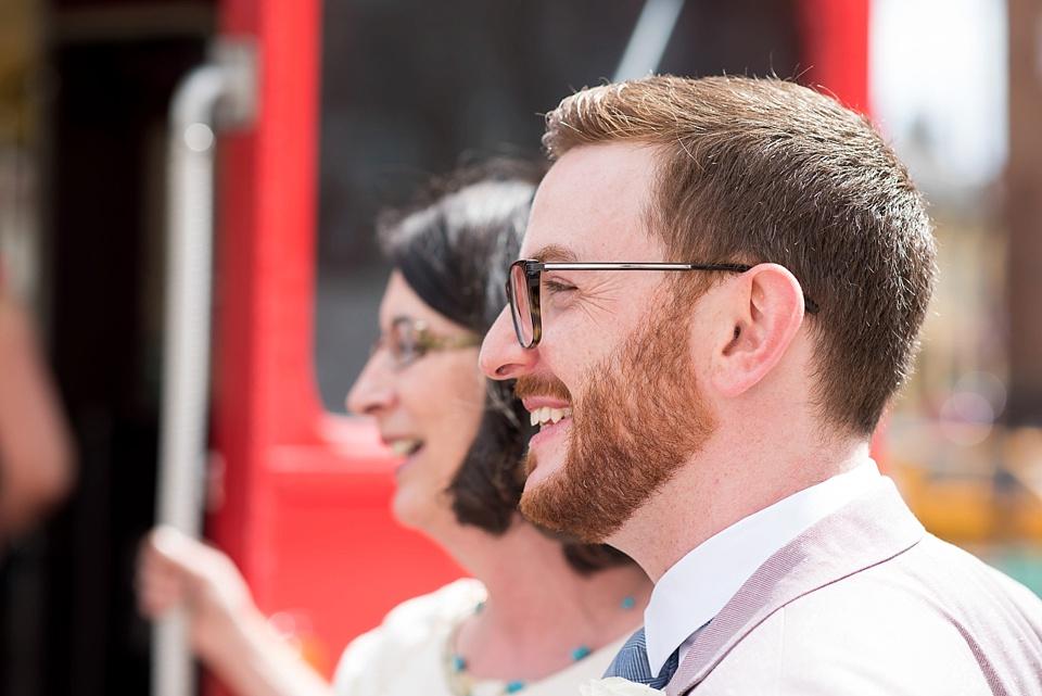 43 Smiling groom at same sex wedding