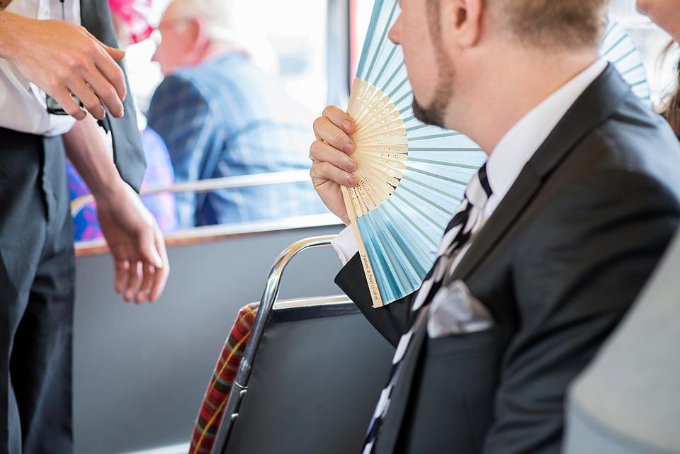 44 Man fanning himself on bus