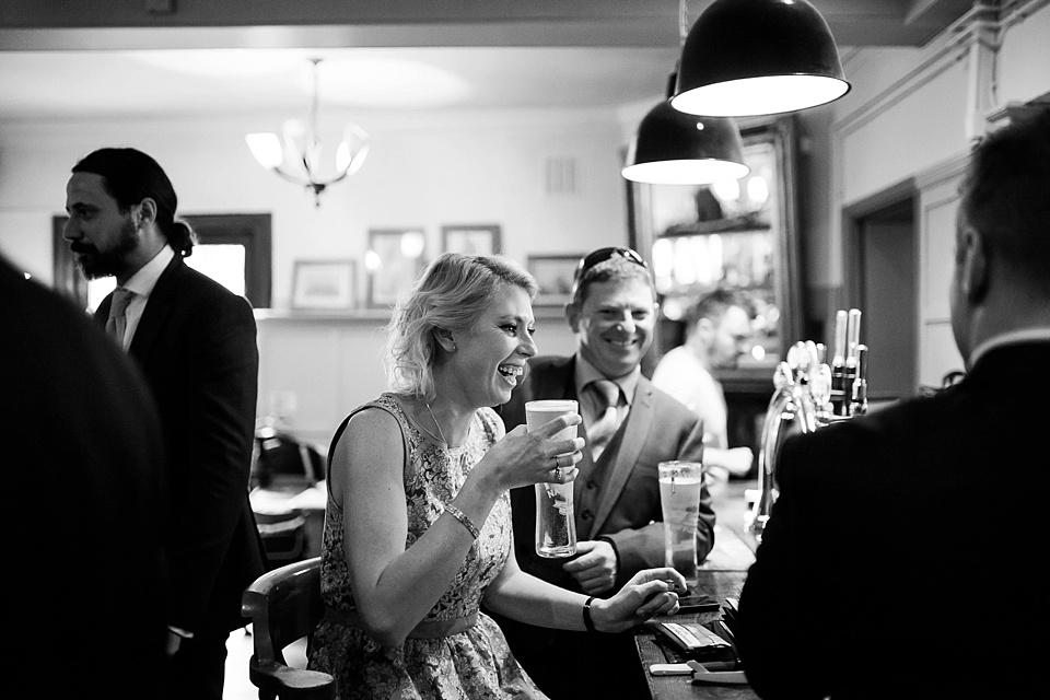 77 Wedding guests having a pint