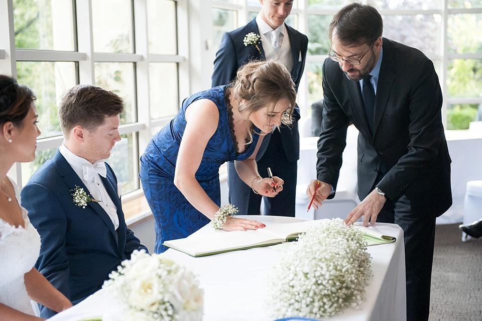 Signing the register London wedding