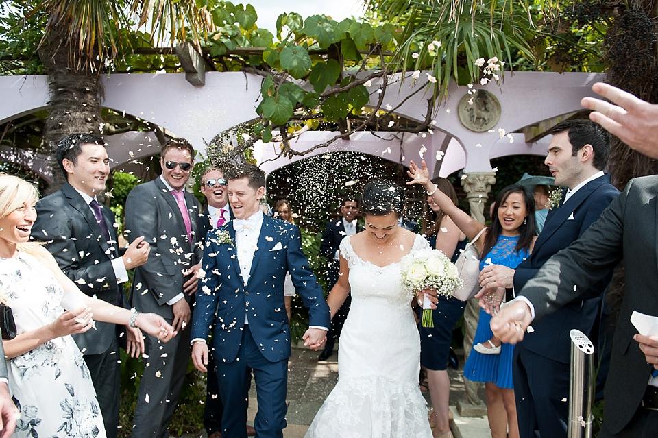 Confetti shower over bride and groom