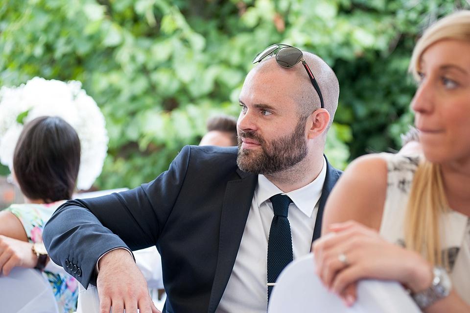 Wedding guests listen to speeches