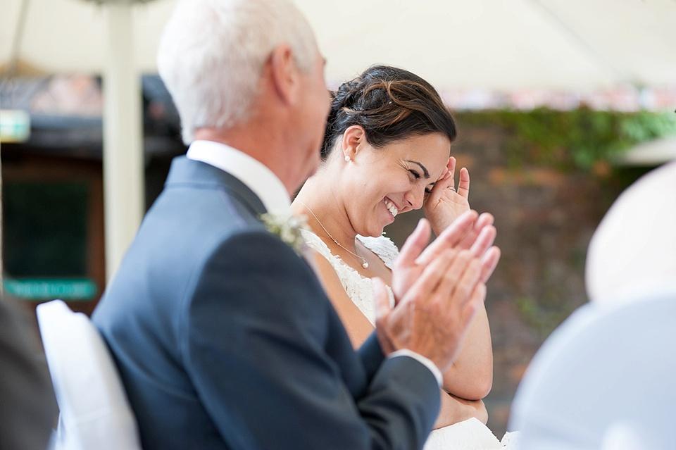 Embarrassed bride at wedding speeches