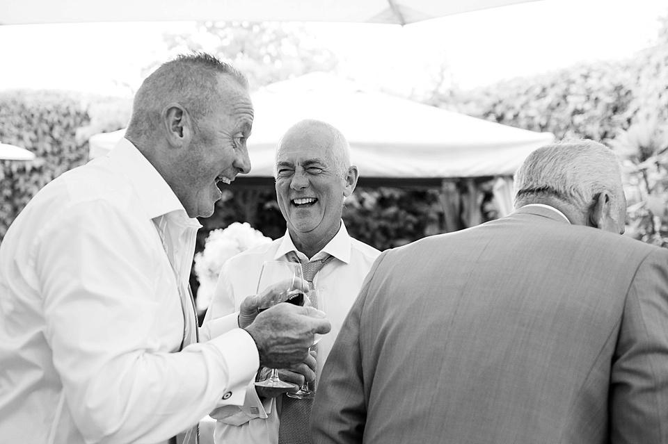 Men laughing London wedding