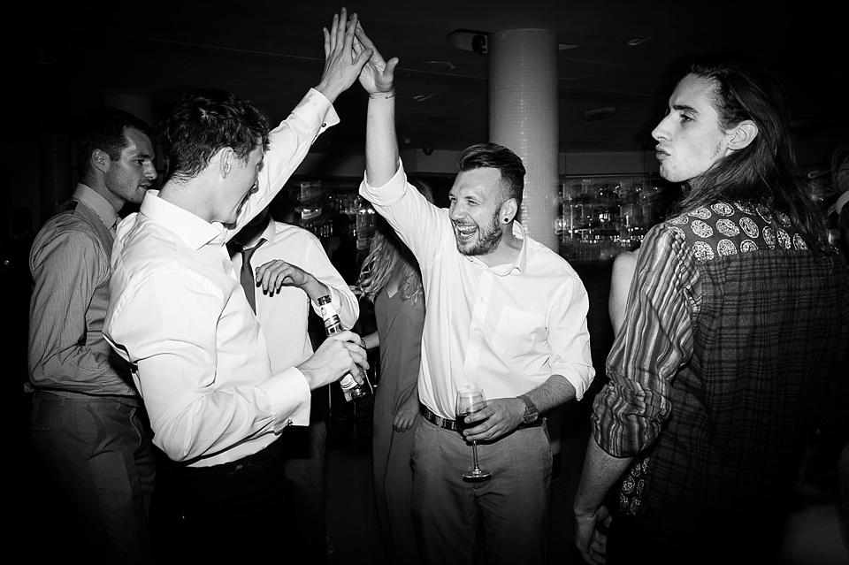 Men high five on dancefloor London