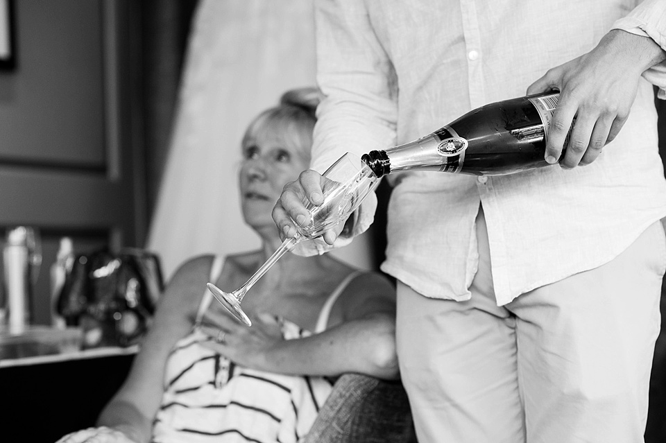 Pouring champagne before wedding