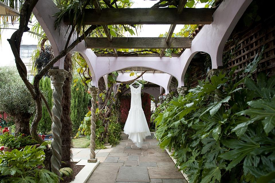 Bride's dress hanging Kensington gardens