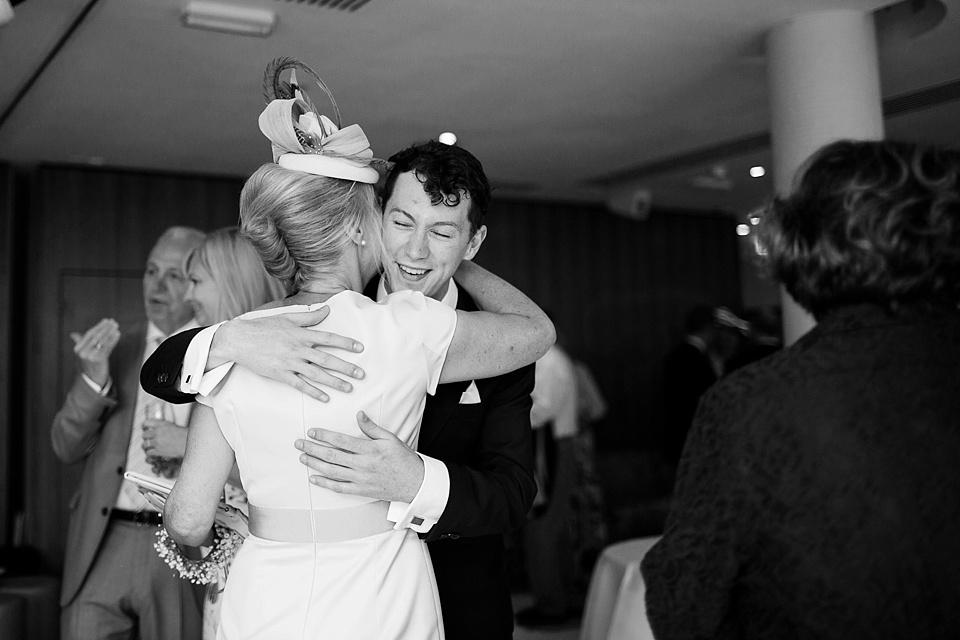 Mother of groom kissing usher