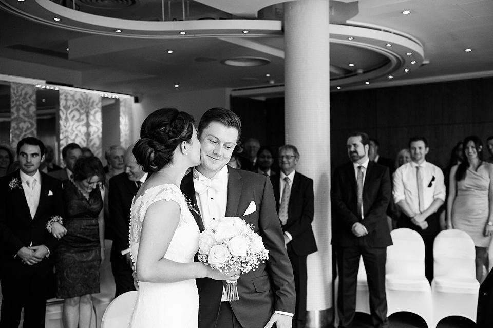 Bride kisses groom London wedding