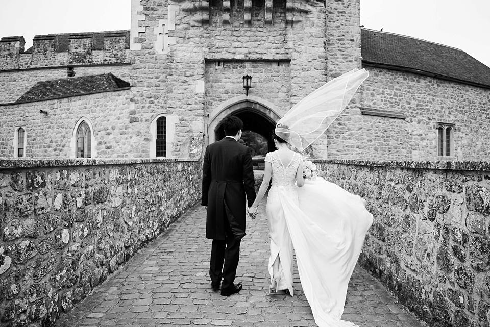 Dramatic wedding portrait Leeds Castle