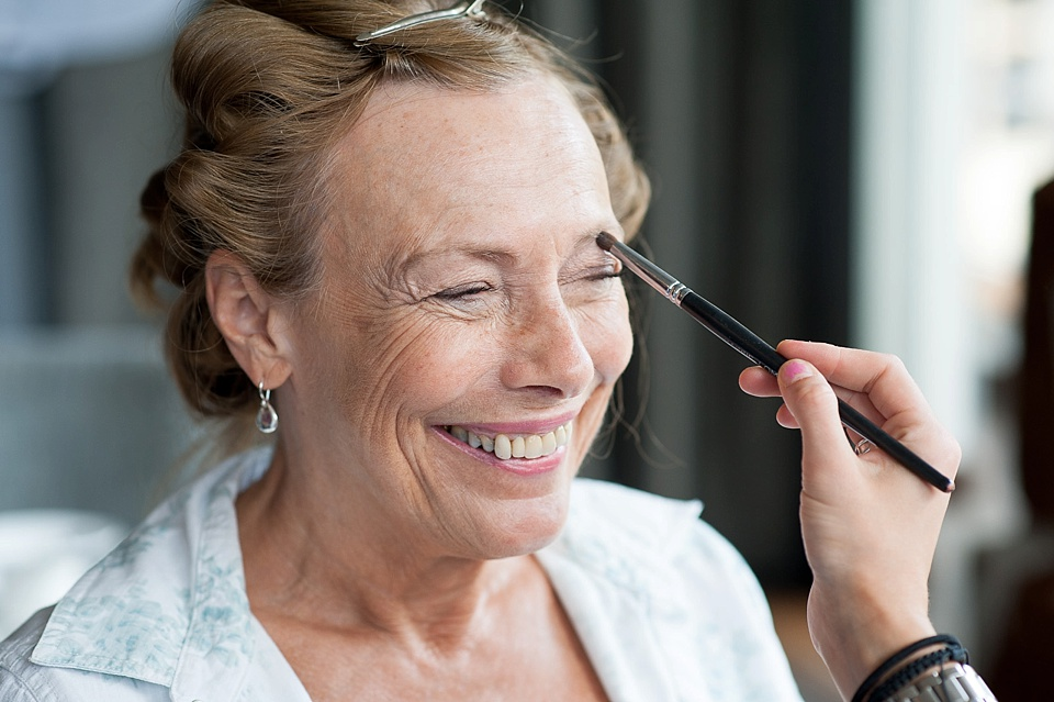 Mother of bride having makeup done