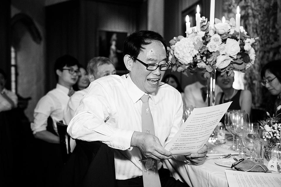 Man laughing at speech Kent wedding