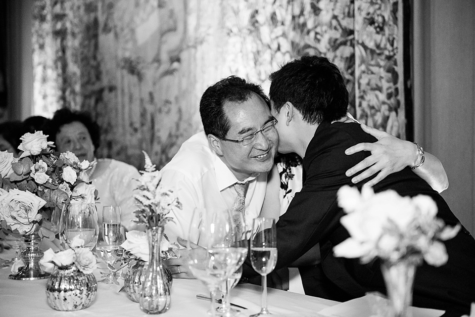 Groom embraces bride's Father Kent