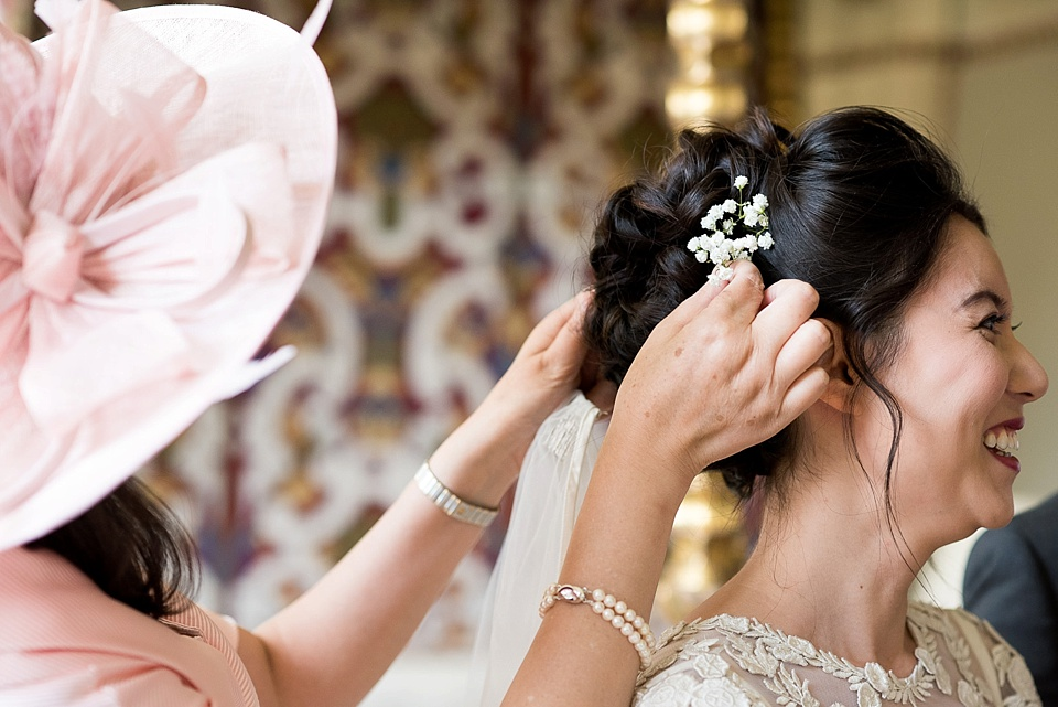 Mother helping bride with final touches