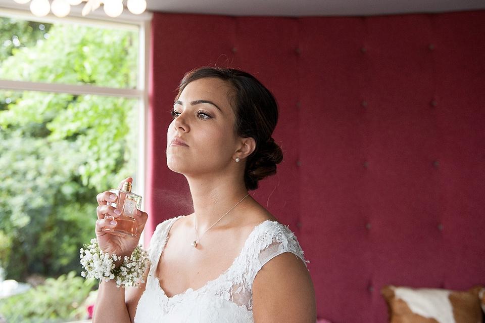 Bride spraying perfume London