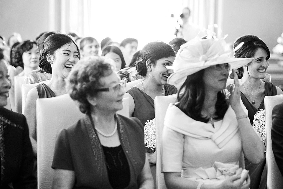 Wedding guests laughing Leeds Castle