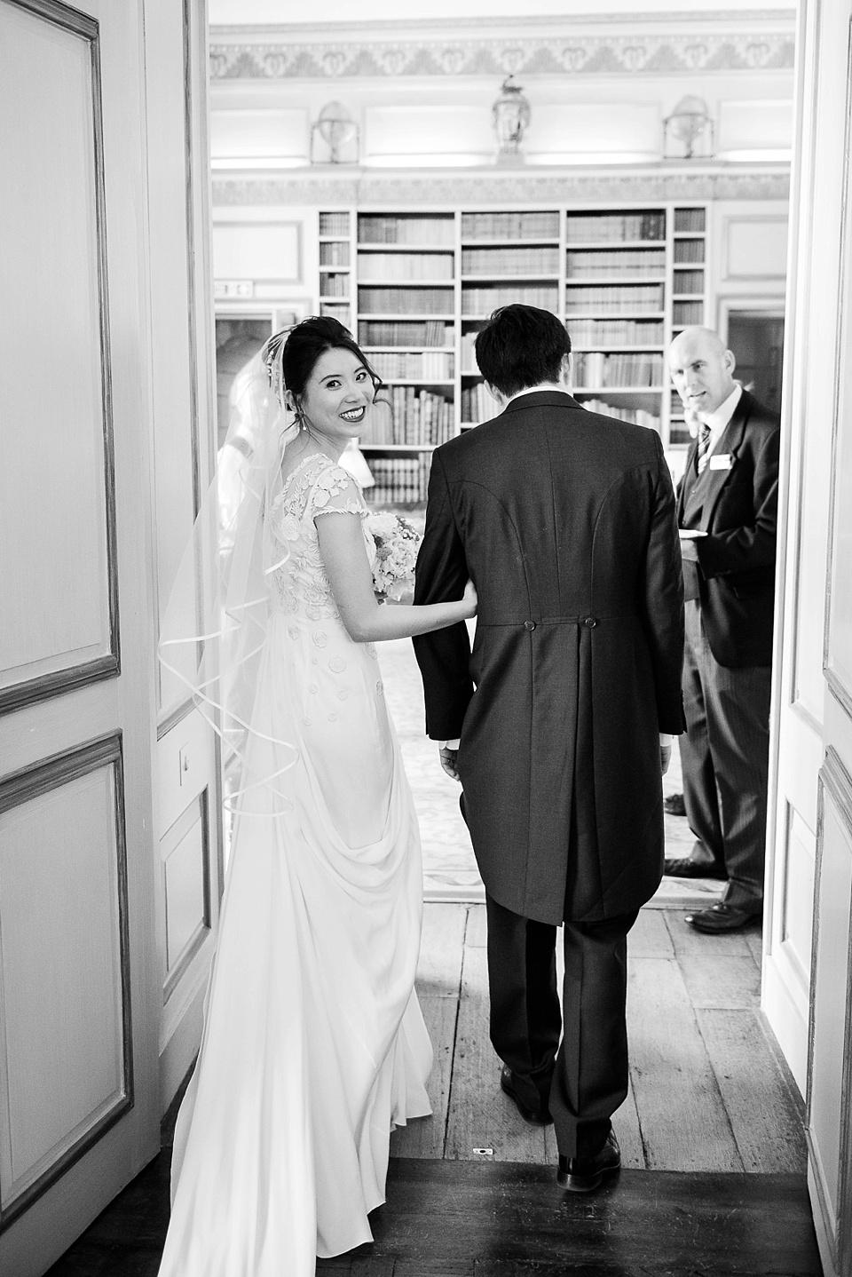 Smiling Kent bride looking over shoulder
