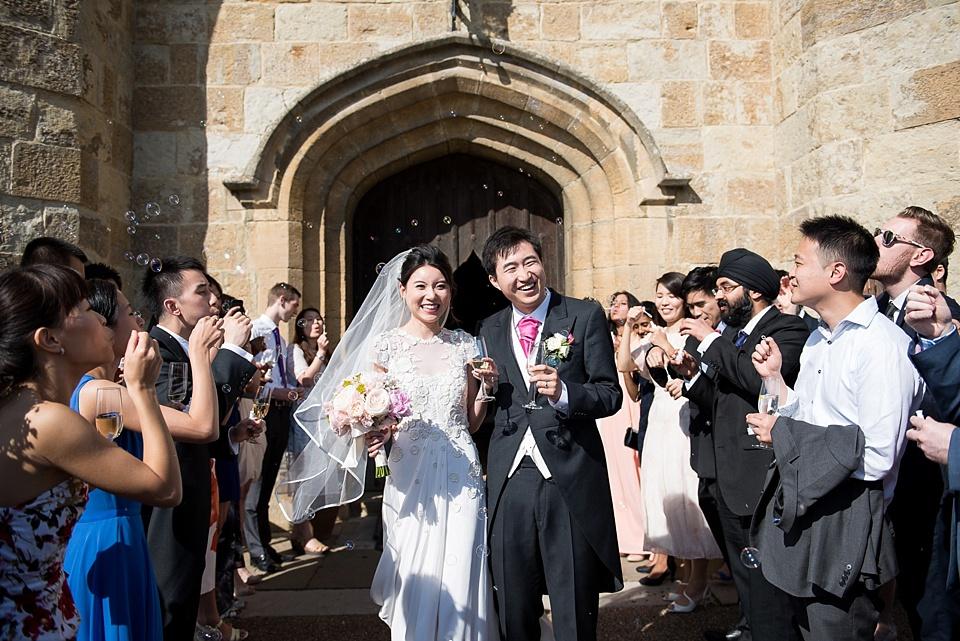 Wedding guests blow bubbles