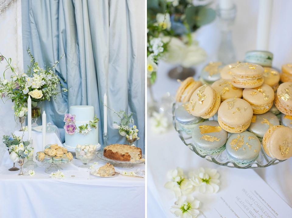Macarons and pastel blue wedding cake cakes by krisanthi