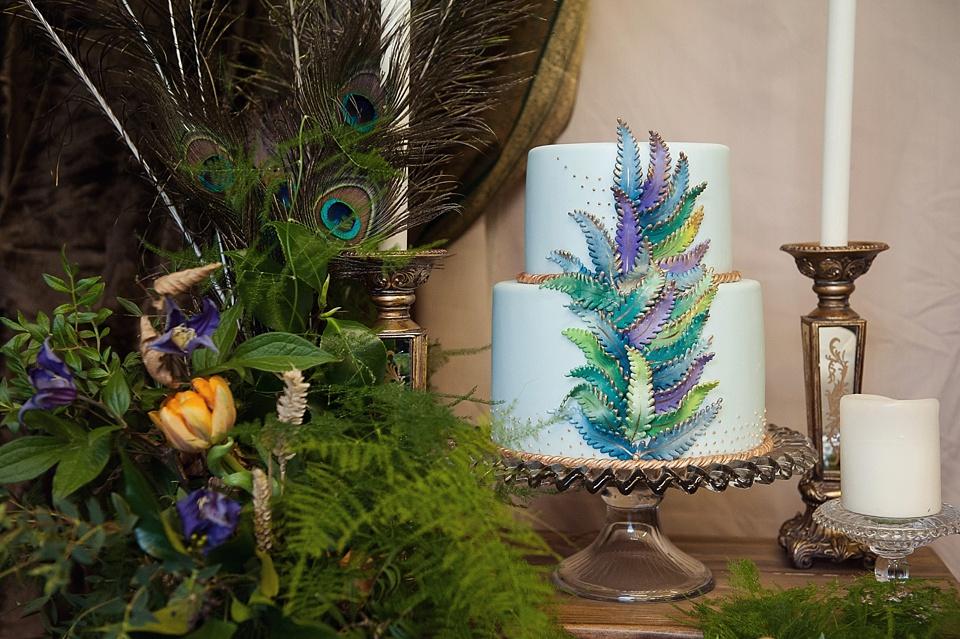 Peacock theme wedding cake - cakes by krisanthi