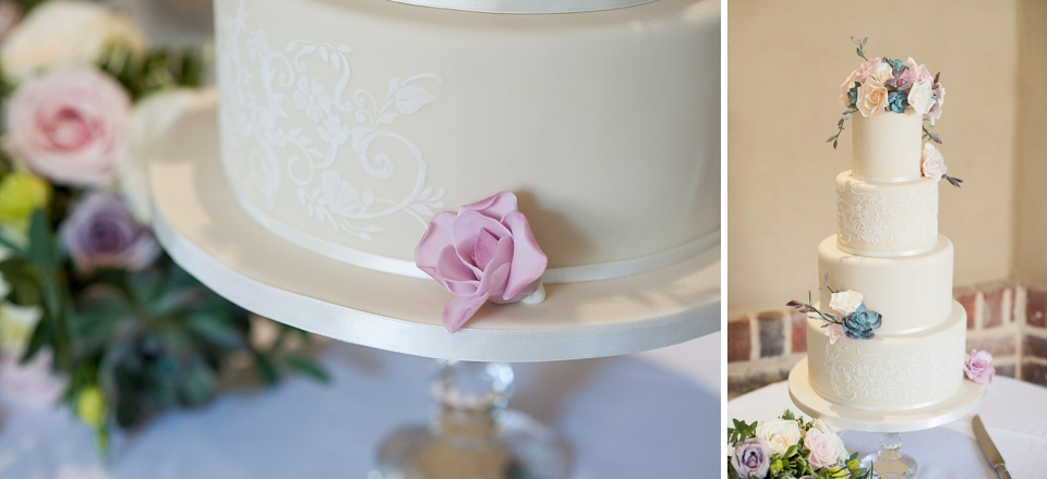 White tiered wedding cake with pastel flowers - fiona Kelly photography