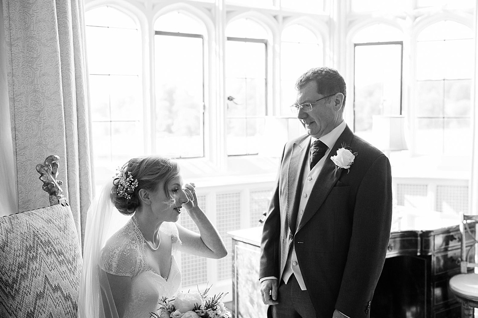 Emotional bride with father before wedding