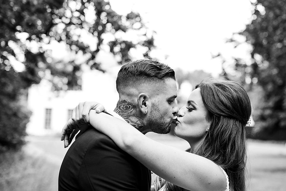 198 Tattooed groom kissing bride