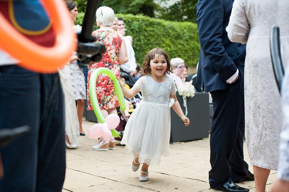 54 Child having fun at wedding