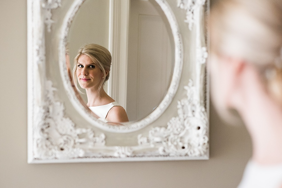 Bride mirror reflection pre-wedding morning Fetcham Park