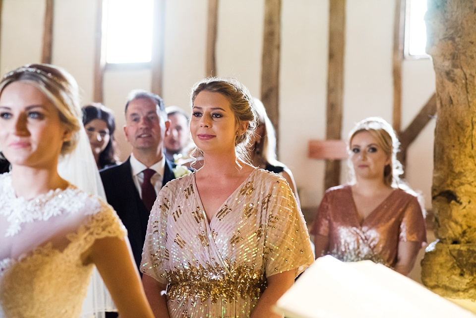 Golden bridesmaids watch wedding ceremony Pledgdon Barn Essex