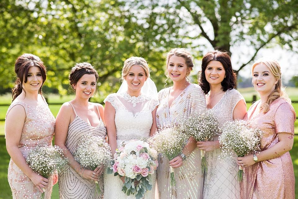 Ronald Joyce bride with bridesmaids Essex outdoor wedding photography