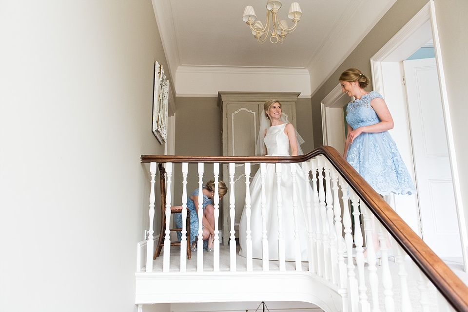 Bride with bridesmaid pre-wedding Fetcham Park