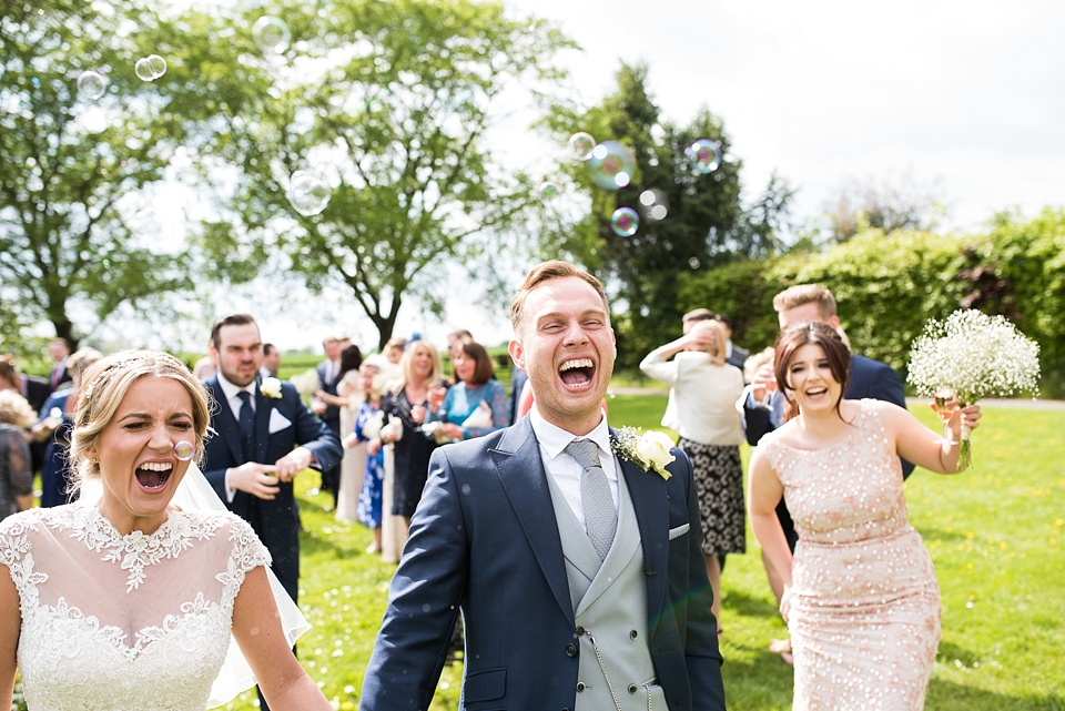 Laughing wedding portrait summer wedding Essex