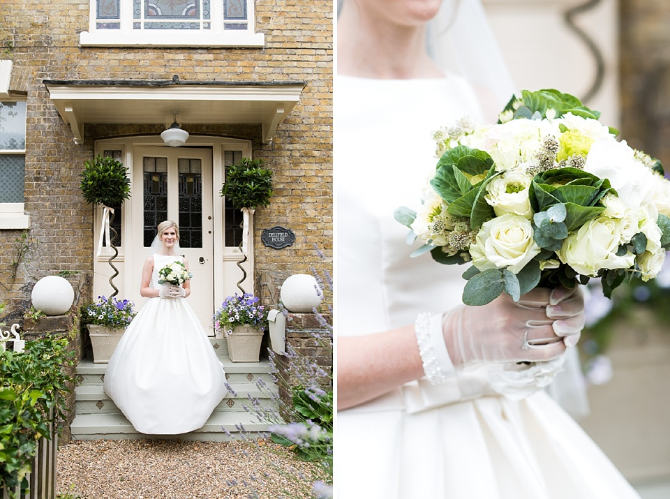 Bride with white floral bouquet at home pre-wedding Fetcham Park