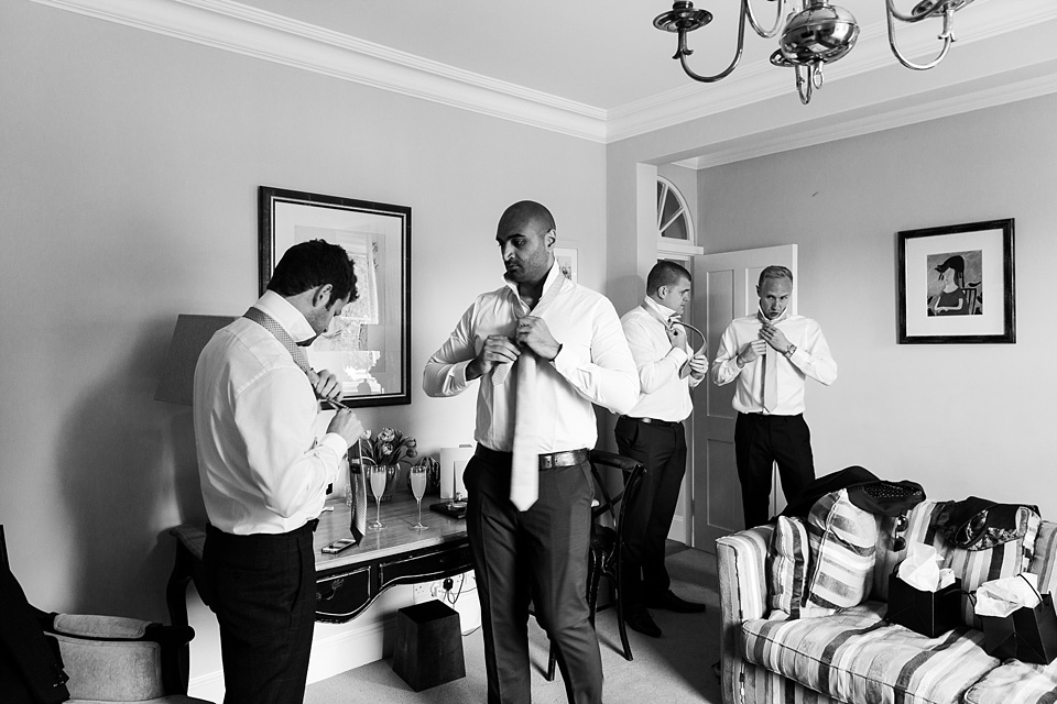 Groom with groomsmen pre-wedding Fetcham Park