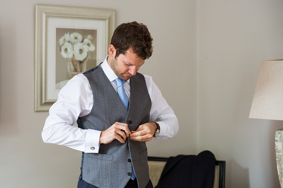 Groom prepares pre-wedding Fetcham Park