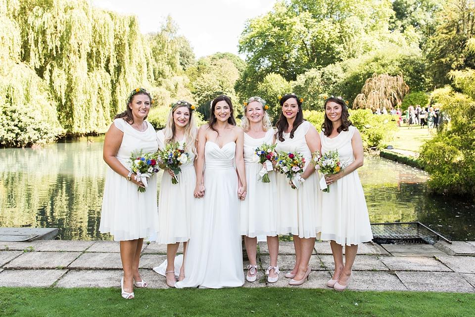 Bride with bridesmaids Surrey wedding