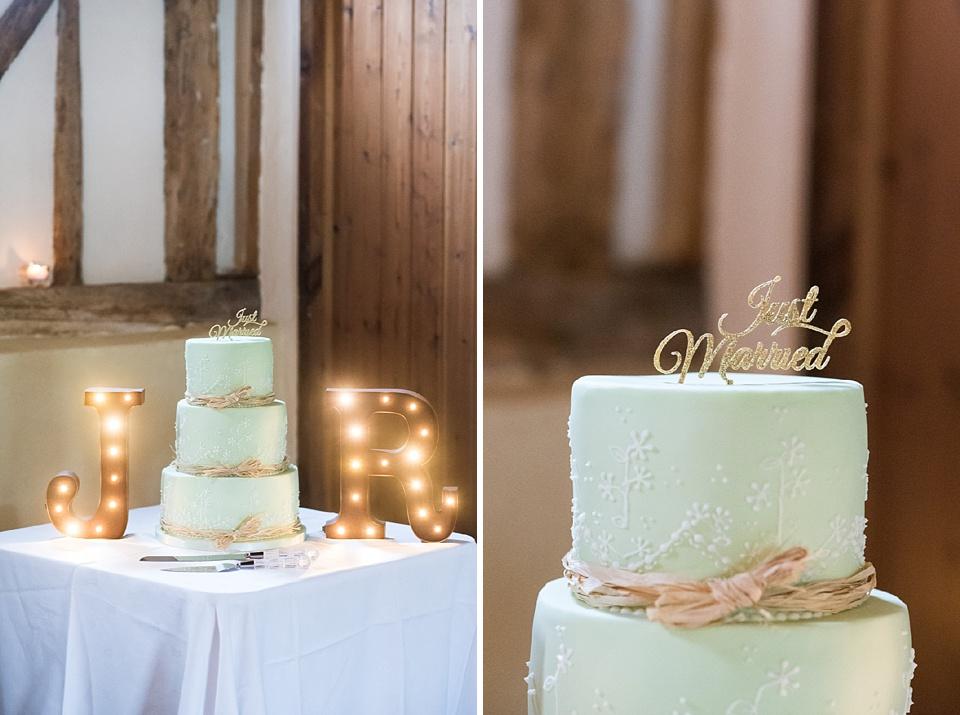 Beautiful turquoise wedding cake with gold ribbon Essex