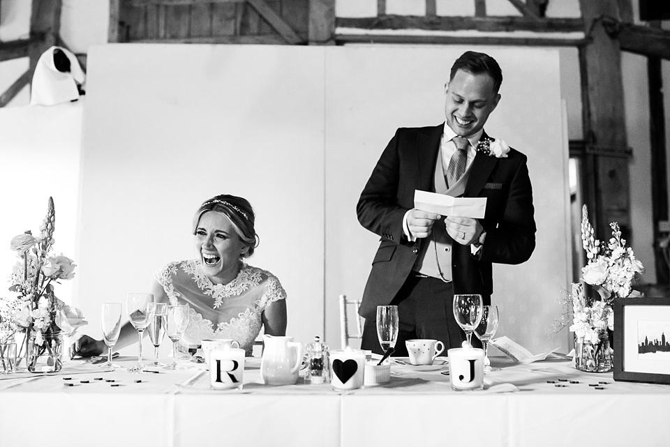 Laughing Ronald Joyce bride during wedding speech from groom Essex