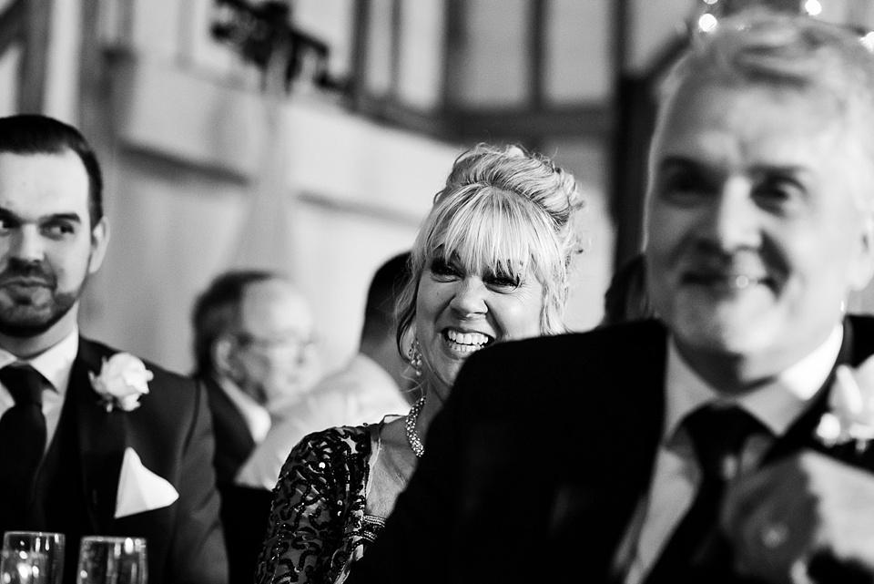 Natural wedding photography captured moment wedding speech giggles Essex