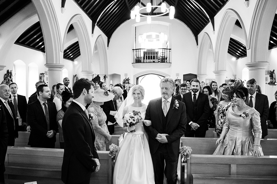 Bride with Father walk down church aisle Fetcham Park wedding
