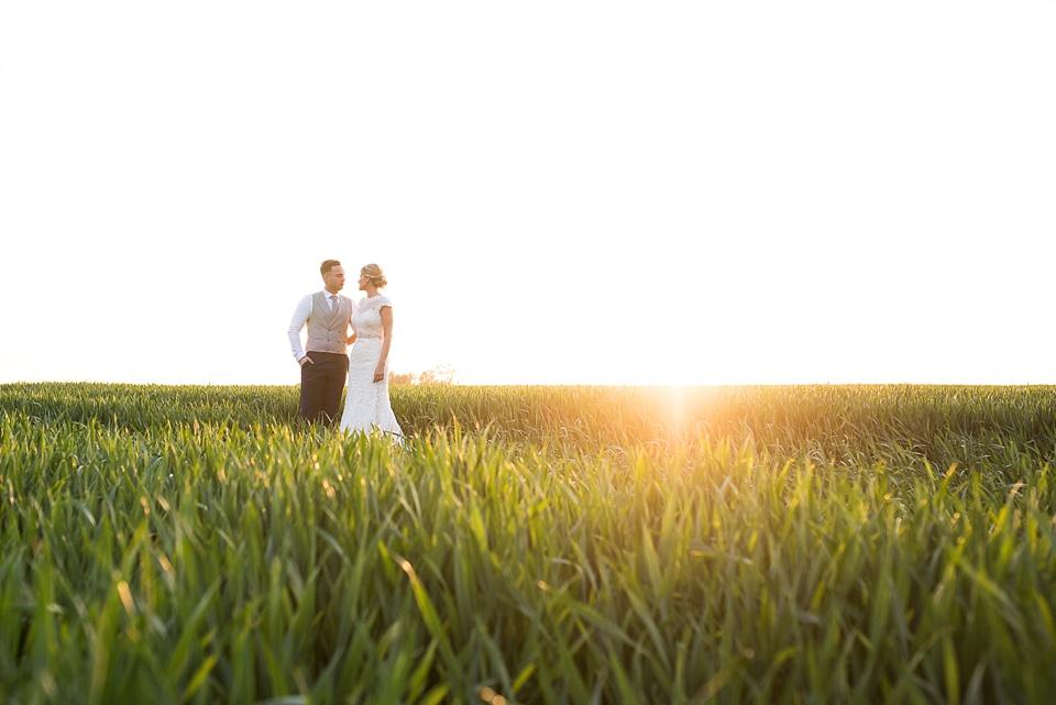 Golden hour wedding portrait amongst Essex countryside