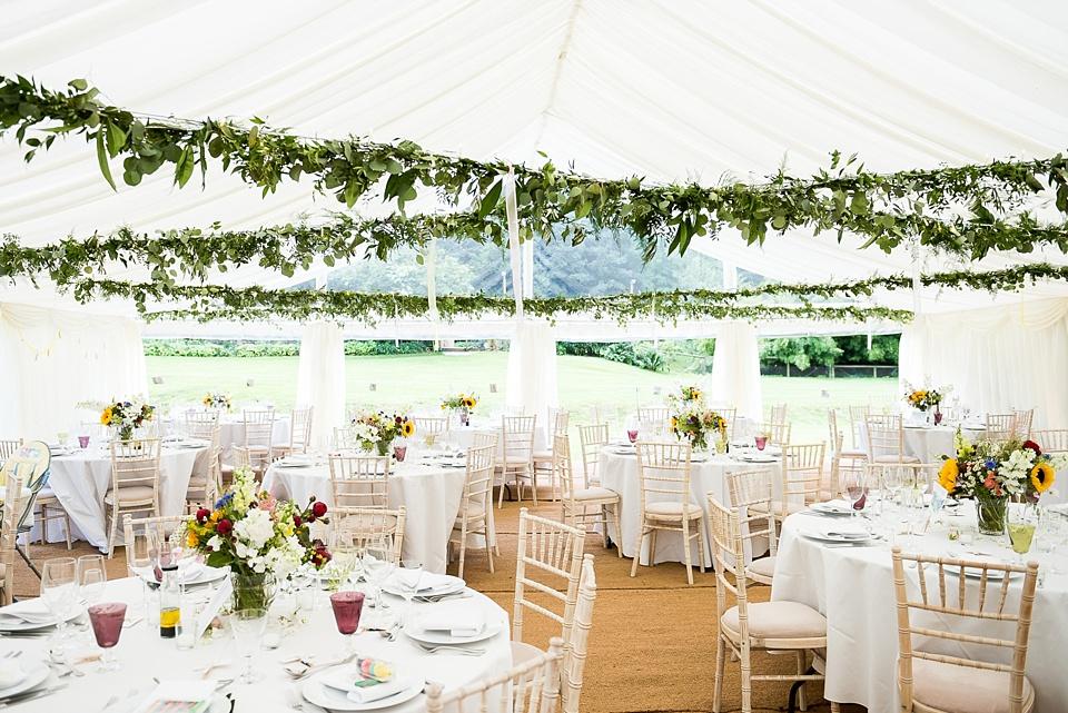 Rustic wedding decor with foliage bunting