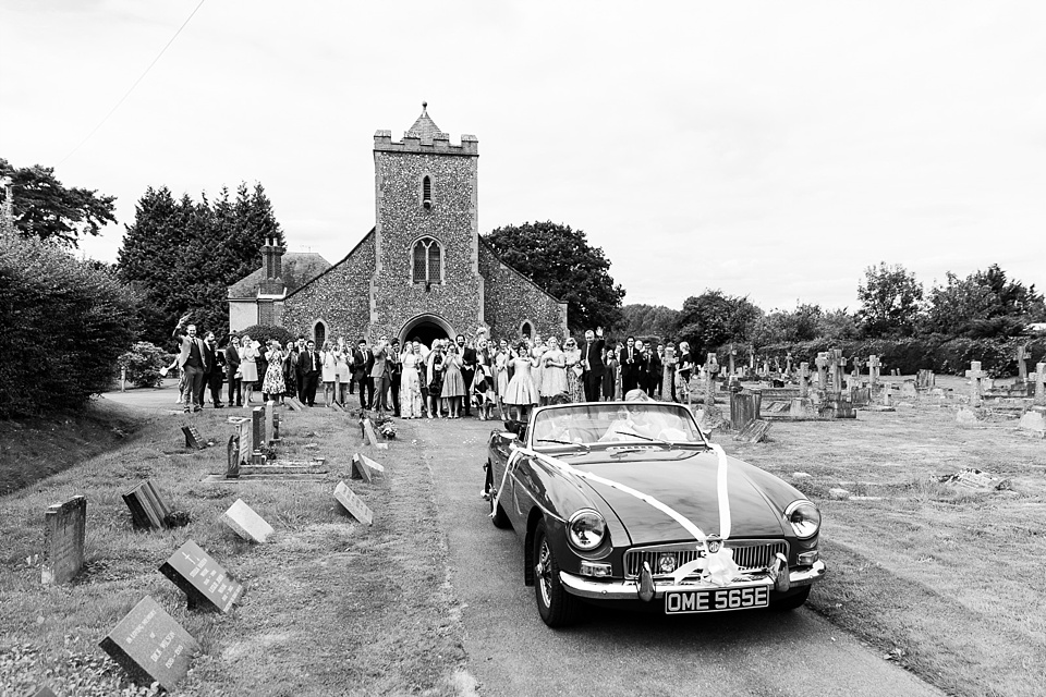 Church wedding portrait with vintage car