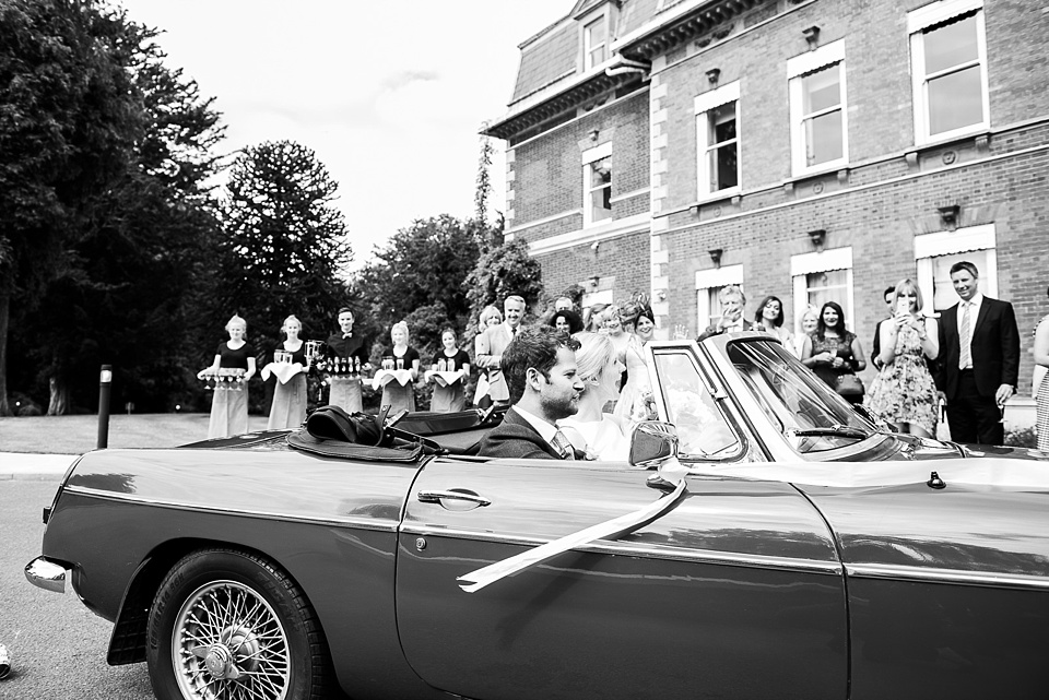 Bride and groom arrive at Fetcham Park Surrey wedding venue