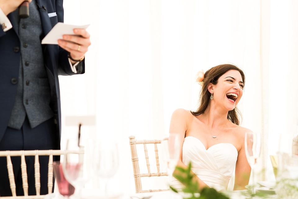 Laughing bride Busbridge Lake wedding venue Surrey