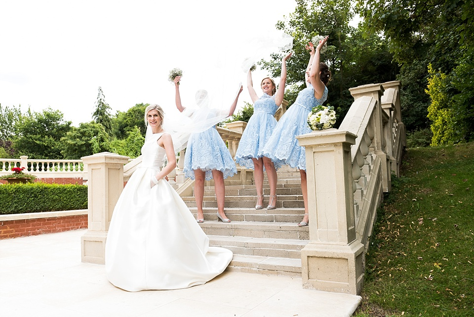 Bride with bridesmaids outside Fetcham Park wedding venue