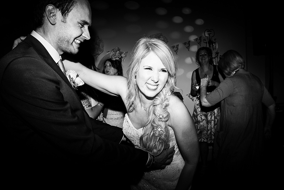 Bride with groom giggling on dance floor at Narborough Hall Gardens Norfolk