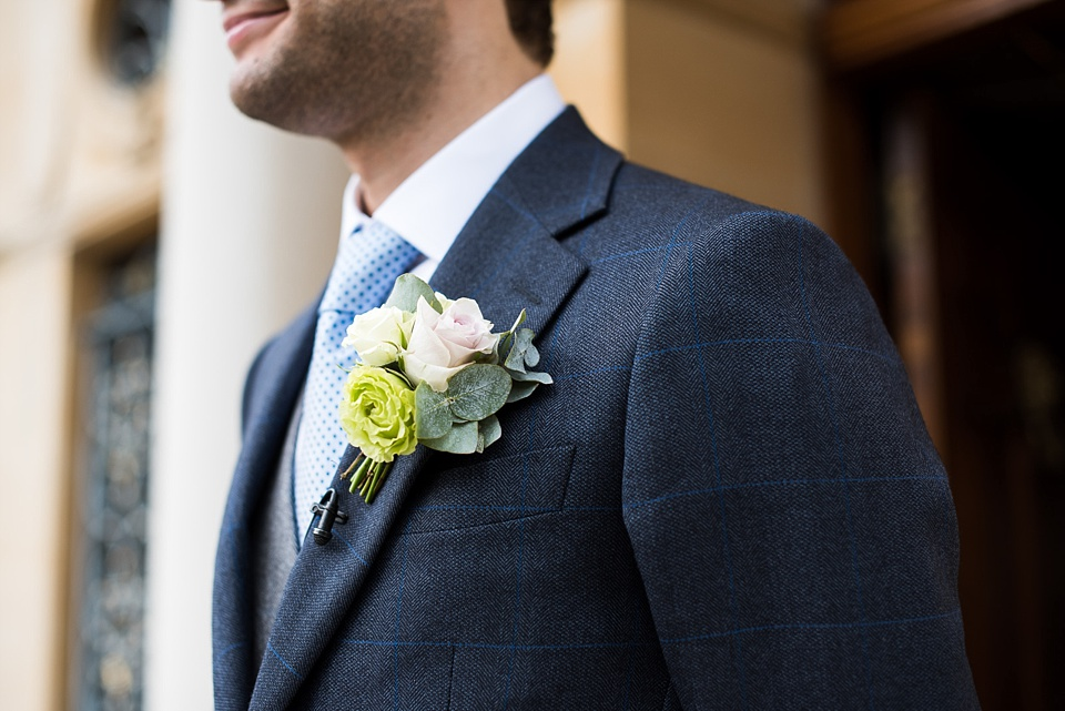 Groom with rose buttonhole Fetcham Park Surrey wedding