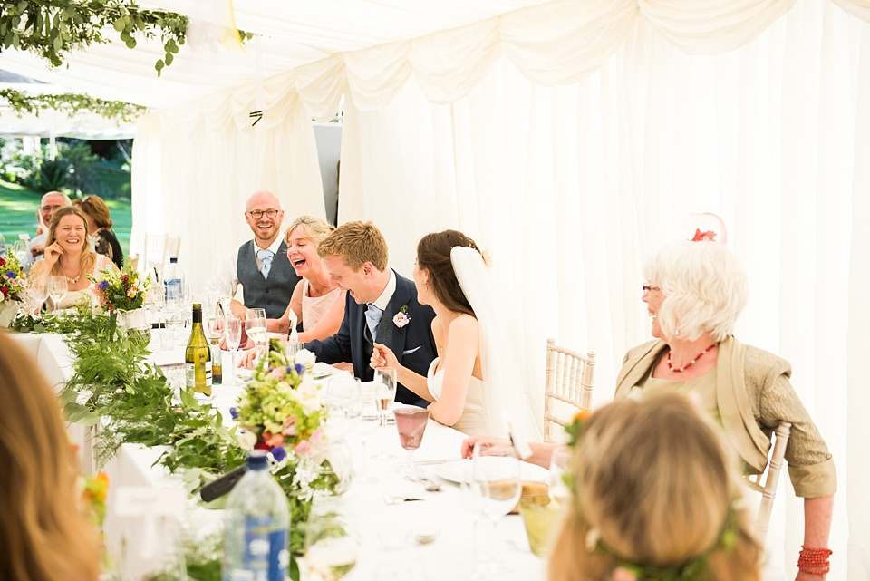 Natural wedding photography laughter during speeches Surrey